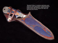 """Mountain Creature"" knife in display type sheath that allows view of handle material while snap retention secures knife in sheath"