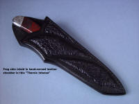 """Tharis Intense"" with frog skin inlaid in hand-carved leather shoulder"