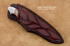 """Thuban"" sheath view in CPM154CM powder metal technology high molybdenum stainless steel blade, hand-engraved 304 stainless steel bolsters, Brecciated Jasper gemstone handle, hand-carved leather sheath inlaid with rayskin"