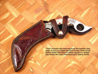 """Titan"" kerambit in display type sheath with open strap handle retention method, sheath has multiple ostrich leg skin inlays in hand-carved leather"