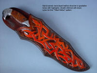 """Tribal"" in hand-engraved 440C high chromium stainless steel blade, hand-engraved 304 stainless steel bolsters, Pilbara Picasso Jasper gemstone handle, sheath of hand-carved, hand-dyed leather shoulder, stand of 304 stainless steel, American black walnut, mesquite, lauan hardwoods, engraved black lacquered brass"