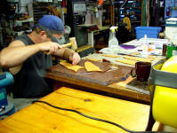 Hand stamping leather sheath faces, constructing fine handmade knife sheaths in leather shoulder