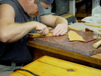 Hand-carving knife sheaths with a scalpel for inlay work. This is long, difficult, meticulous hand work at very close range