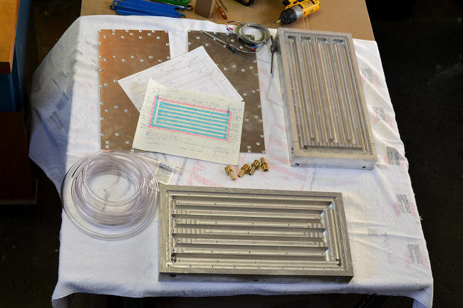 Contact block heat exchanger parts before assembly