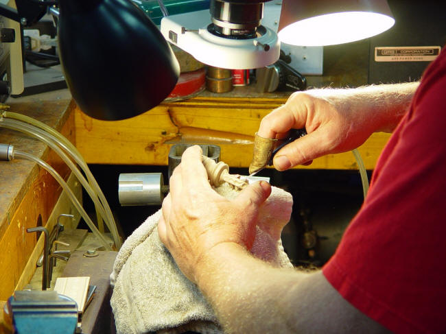 Hand-engraving a cast bronze sword pommel