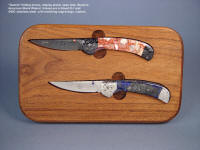 """Gemini Twins"" linerlock folding knives in simple display stand with several display options. Handles are lace agate and Peruvian lapis lazuli gemstone"