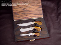 """Trophy Game Set"" in case of imbuya and red oak. Knives are D2, hand-engraved brass, tiger eye gemstone handles"
