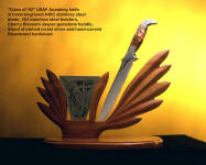 USAF class of 1962 commemorative knife with display stand of hand-carved bloodwood exotic hardwood and etched nickel silver. Knife is engraved stainless steel with cherry blossom jasper gemstone handle
