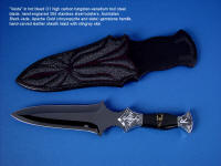 """Vesta"" Dagger, obverse side view in hot-blued O1 high carbon tungsten-vanadium tool steel blade, hand-engraved 304 stainless steel bolsters, Australian Black Jade and Apache Gold (chrysopyrite and slate) gemstone handle, hand-carved leather sheath inlaid with stingray skin"